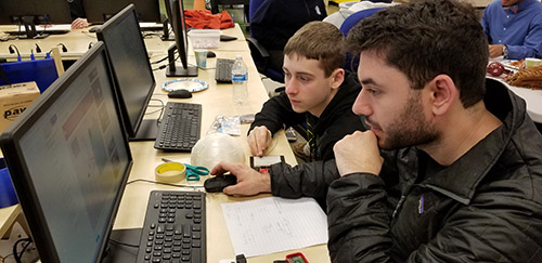 mentor and student at computer