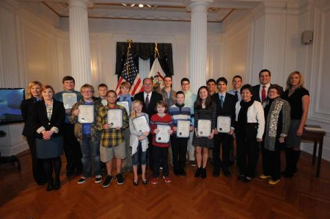 Fifteen West Virginia elementary school, middle school and high school students were honored Wednesday, Nov. 30, 2016 for designs of the West Virginia State Capitol building based on the Minecraft fantasy computer game.